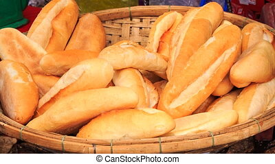 one takes fresh white wheat rolls from wooden plate -...
