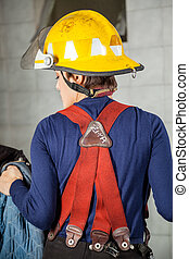 Rear View Of Firewoman In Uniform - Rear view of firewoman...