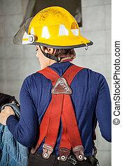 Rear View Of Firewoman In Uniform - Rear view of firewoman...