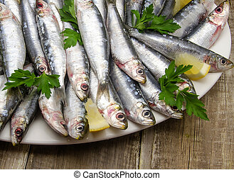 Fresh sardines with parsley and lemon slices
