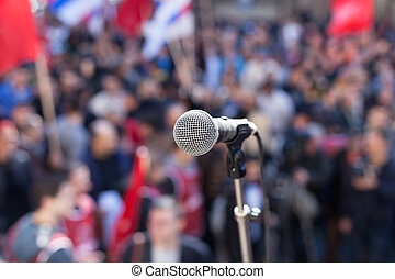Protest Public demonstration - Microphone in focus against...