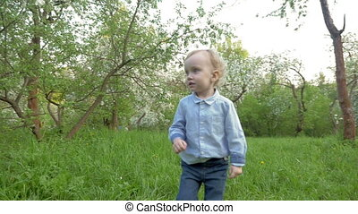 Little Boy Walking among the Trees - Steadicam slow motion...