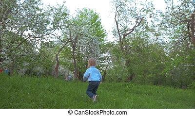 Boy Walking in the Garden