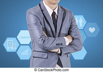 Business man standing on blue background.