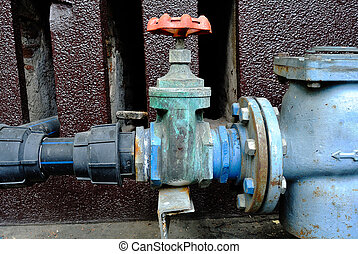 Old or Grunge Rusty Industrial Tap Water Pipe and Valve
