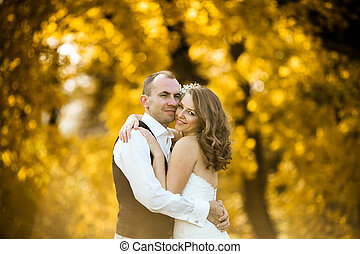 beautiful couple enjoying embrace of each other and tenderly...