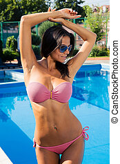 Attractive woman posing in bikini