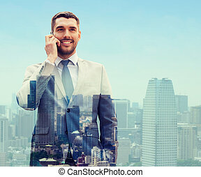 smiling businessman with smartphone in city - business,...