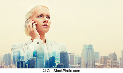 serious businesswoman with smartphone in city - business,...