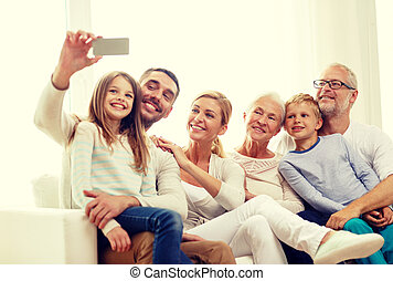 happy family with smartphone at home - family, happiness,...