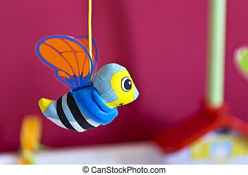 Little bee hanging above baby bed - Little bee hanging above...