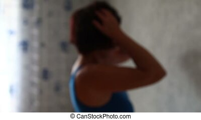Woman standing at the wall and suff - Medical Depression...