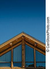 Roof of Log Cabin on Blue Sky