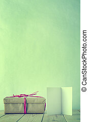 Simple Tied Gift with Blank Open Card - A gift box wrapped...