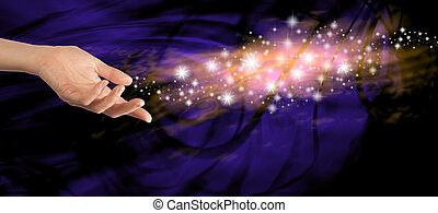 Sending out special energy - Female hand outstretched with a...