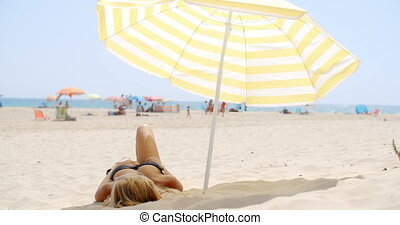 Girl Relaxing on the Beach under Umbrella on Slow Motion...