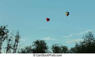hot air balloons in the blue sky aerostats - Two hot air...
