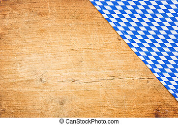 A wooden background with a bavarian table cloth