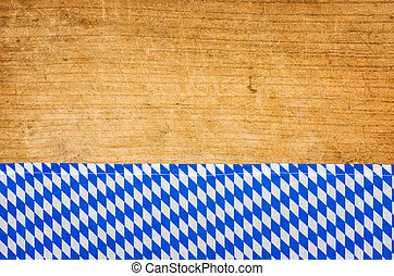 Rustic wooden background with a bavarian tablecloth