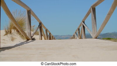 View on a Bridge on Sandy Beach in Slow Motion Video