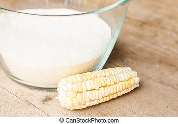 Cornmeal - Corn flour on a wooden table