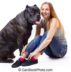 girl sitting and smile next to his dog Cane Corso. square...