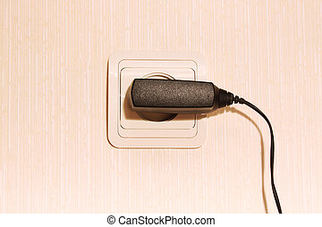 wall plug with a cable - Beige wall plug with a cable for a...