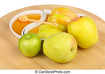 apples and dhoney - apples and dipping slices of apple in...