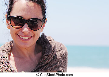Portrait of beautiful 35 years old woman on the beach