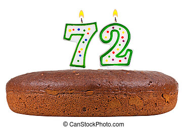 birthday cake with candles number seventy two isolated on...