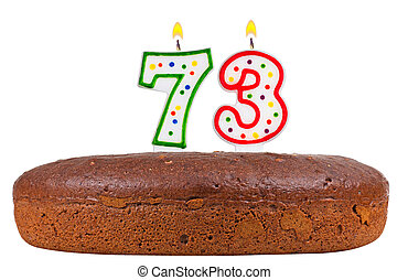 birthday cake with candles number seventy three isolated on...