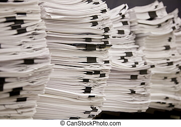 Stacks of Tax and Legal Papers - Stacks of White Legal and...