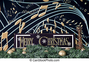 Merry Christmas Tune - A black and gold Merry Christmas sign...