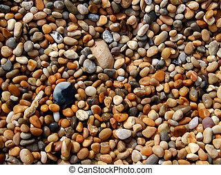 pebbles - An abstract background of shiny, wet, rounded...