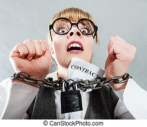 Furious woman with chained hands and contract - Business and...