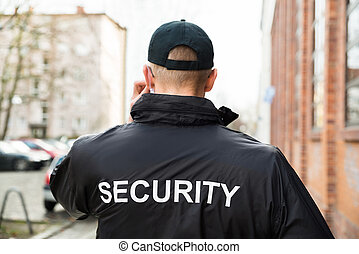 Security Guard Wearing Jacket - Close-up Of Male Security...