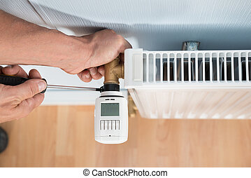 Technician Installing Digital Thermostat - Close-up Photo Of...