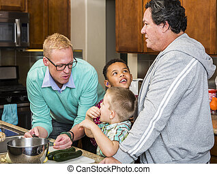 Same Sex Couple and Kids - Preparing a meal with gay couple...