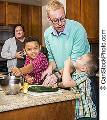 Same Sex Couple with Kids in Kitchen - Gay couple preparing...
