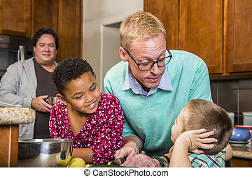 Male Couple and Kids in Kitchen - Gay men preparing a meal...