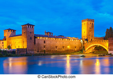 Night view of Castelvecchio in Verona, Italy. -...