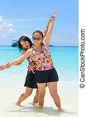 Mother and daughter on the beach at Similan islands, Thailand