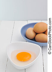 Yolk - Yolk on White Dish and Wooden Textured