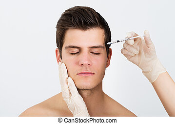 Person Hands Injecting Syringe With Botox - Close-up Of...