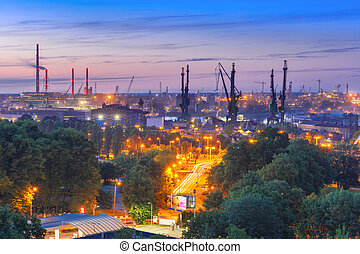 Gdansk Shipyard at night, Poland - Aerial industrial view of...