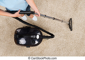 Woman Vacuuming Carpet - Close-up Of Woman Vacuuming Carpet...