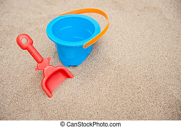 Bucket and spade - Plastic bucket and spade on a sandy...