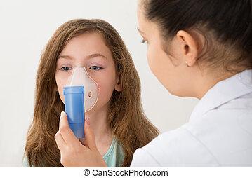 Doctor Using Inhaler Mask On Girl