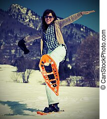 beautiful woman with snowshoes in the snow - beautiful young...