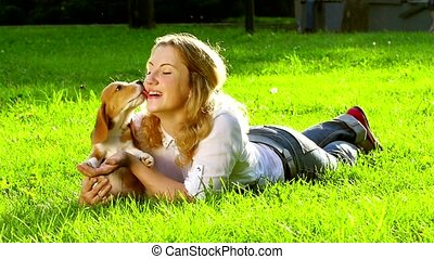 Outdoors portrait happy woman with a dog beagle playing on nature